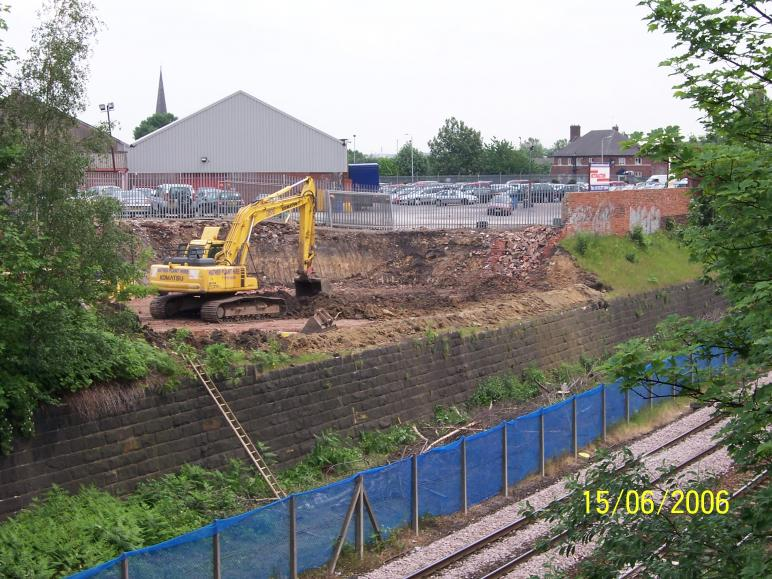 North Abutment being dug out and wall being broken down