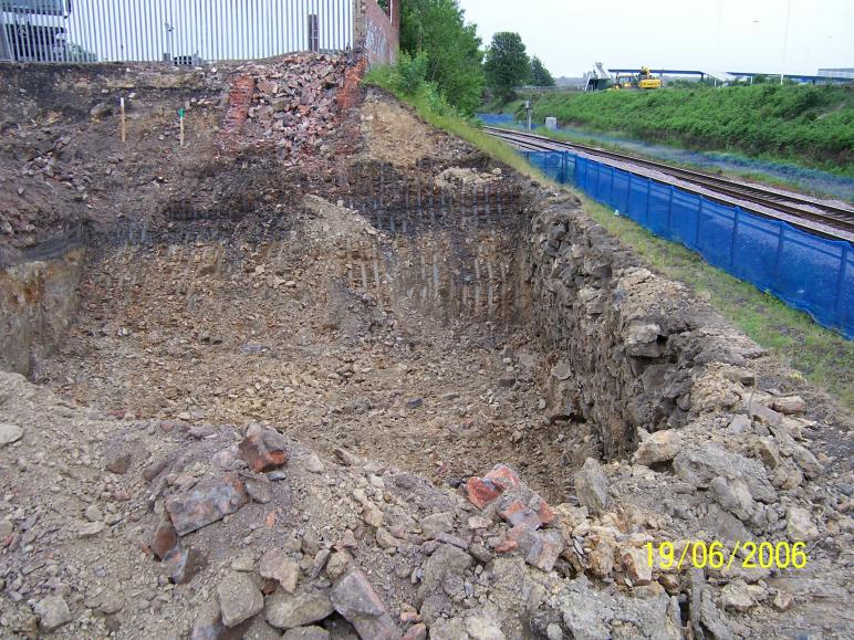 North abutment dig behind the existing stone wall.