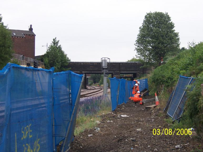 ASTE rail installing cable trough route on the South Abutment