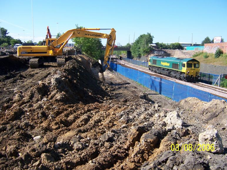 South Abutment being excavated out with the trains running.
