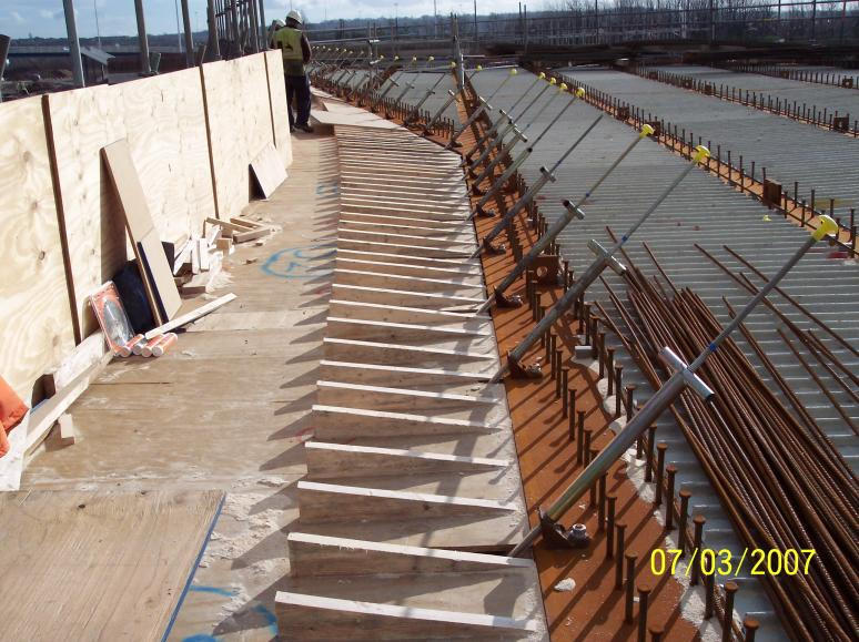 Cantilever angle sections cut to follow the parapet profile