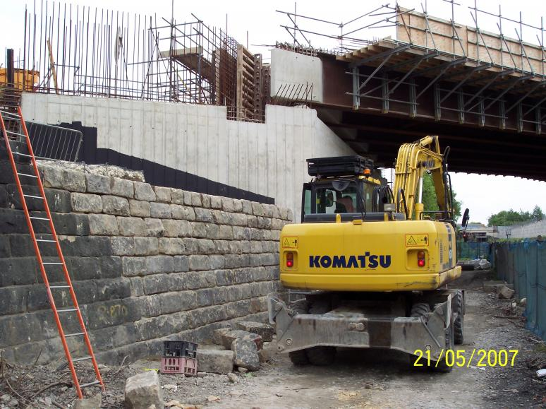 Stone faced abutment being reconstructed.