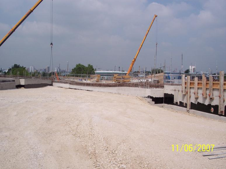 Backfill progressing at the back of the abutment with the ballast wall constructed.
