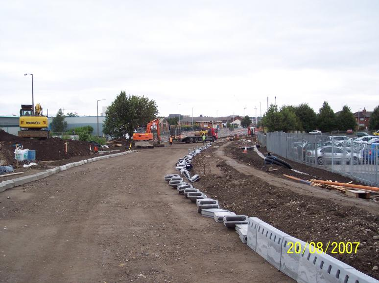 Kerbs being installed on the approach to the bridge