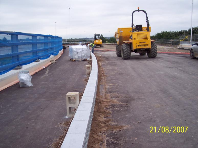 Kerbs being laid on the deck