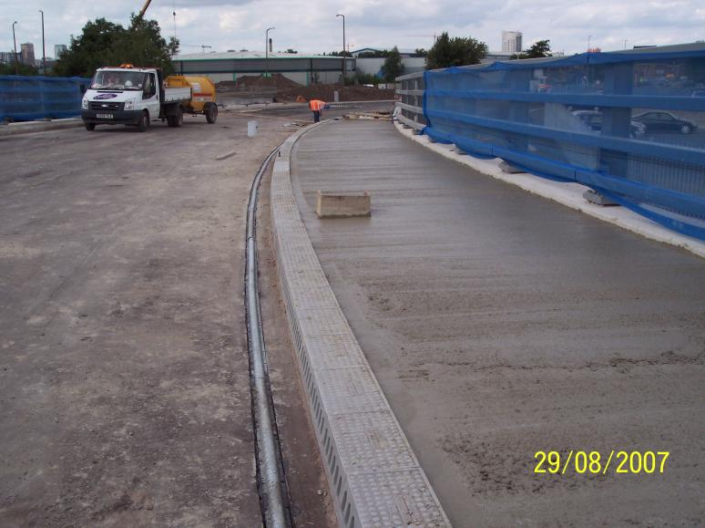 Concrete being placed in the bridge verge