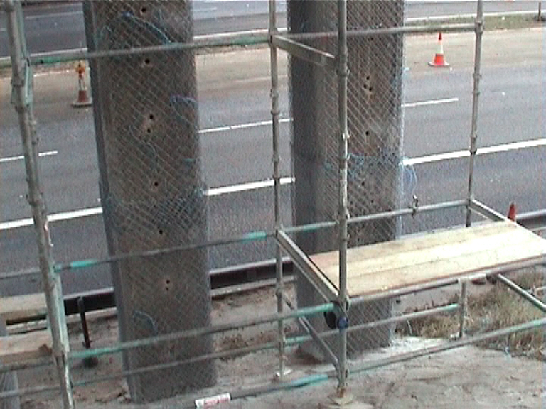 Drilling to columns and wrapped with weld mesh