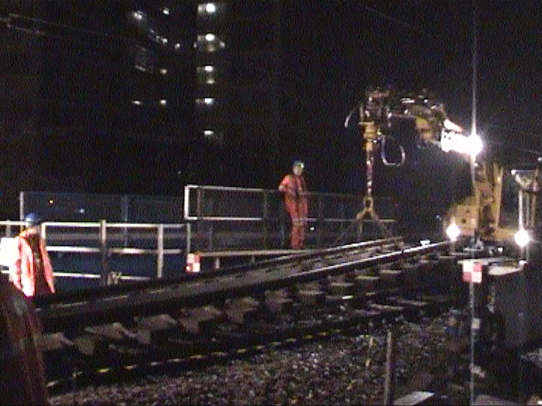 Track being lifted by bridge