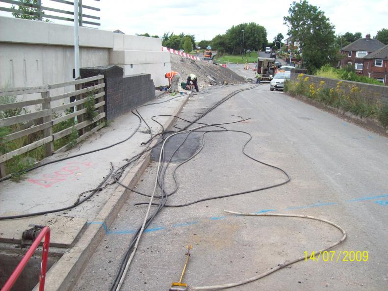 Cables and services previously diverted onto the new bridge - old cables being recovered.