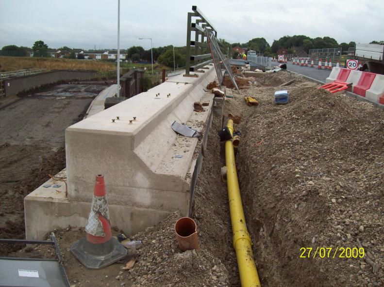 New Gas main being installed over the bridge.