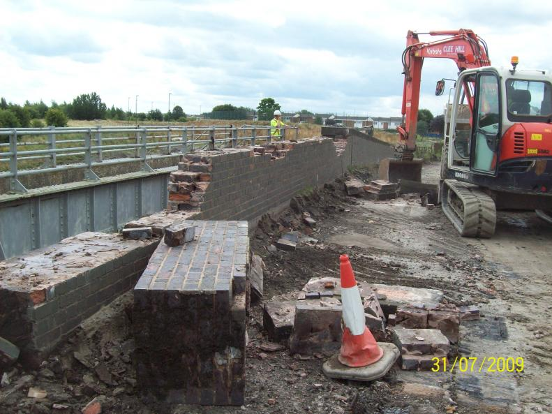 Brick Parapet being pulled over from the bridge deck