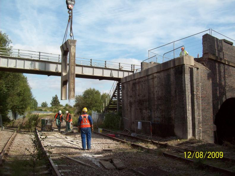 Crane lifting out the final trestle