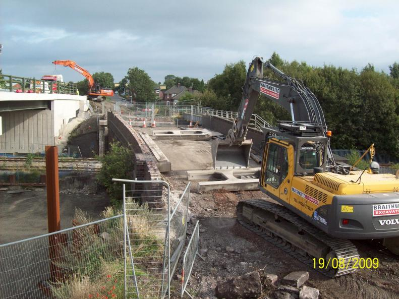 Braithwaite Demolition clearing trestles of the bridge as Ivor King finish and move away.