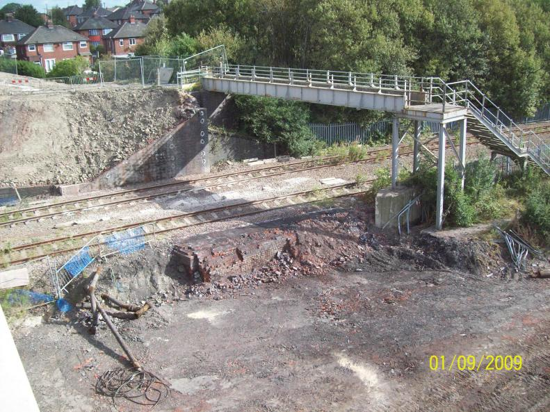 Clear up in progress with North abutment broken down.