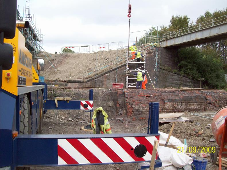 Crane lifting in stone copings reclaimed from the bridge parapets