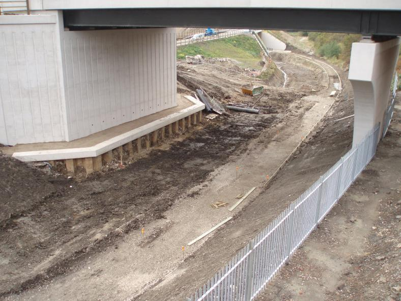Fence being installed between the canal and the railway.