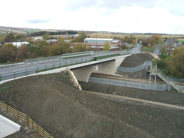 Final Project completed with fences in place. New bridge fully open.
