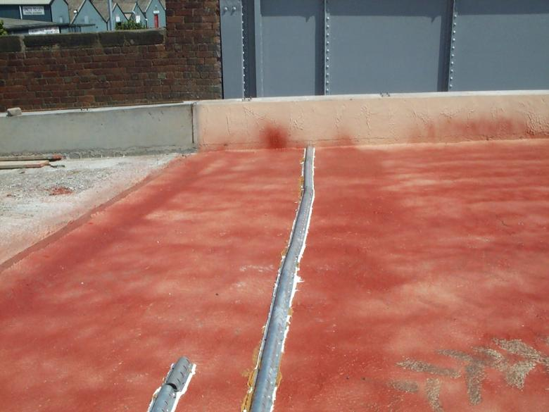 Honel drains fixed to the deck - red tack coat